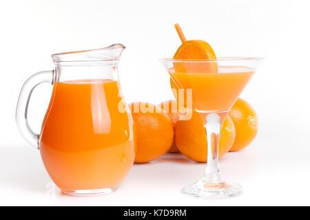Glass jar and glass with orange juice. - Stock Photo