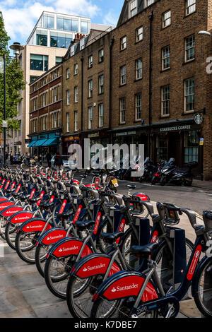 Santander Cycles For Hire At A Docking Station, London, UK - Stock Photo