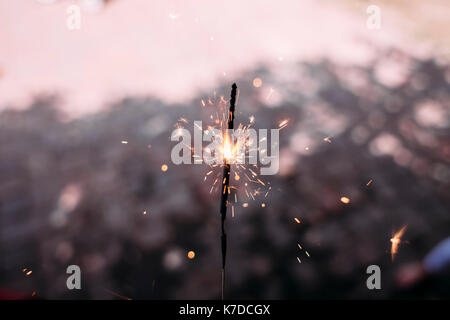 Close-up of lit sparkler during dusk - Stock Photo