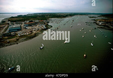 AJAXNETPHOTO. SOUTHAMPTON,ENGLAND - SOUTH COAST YACHTING MECCA - ENTRANCE TO THE HAMBLE RIVER WITH HAMBLE POINT TO LEFT AND JUST ABOVE THE MARINA, HAMBLE VILLAGE. RIVER RUNS SIX MILES NORTH TO OLD MILL AT BOTLEY. PHOTO:JONATHAN EASTLAND/AJAX REF:71507 037