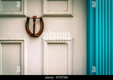 A rusty horseshoe door knocker mounted on a weathered Virginia door. - Stock Photo & HOUSE DOOR KEYS ON BLUE BACKGROUND Stock Photo: 7447156 - Alamy