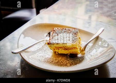 A plate of Tiramisu, a favorite dessert dish in Italian households. - Stock Photo