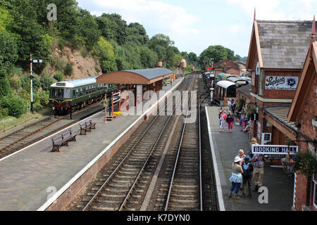 View along the track from the footbridge at Bewdley station on the Severn Valley heritage Railway with passengers - Stock Photo