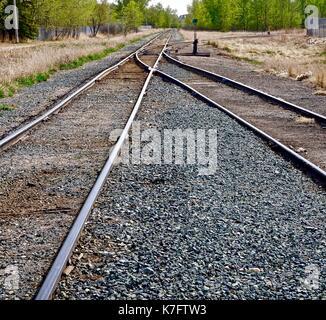 Crossing Railway Tracks - Stock Photo