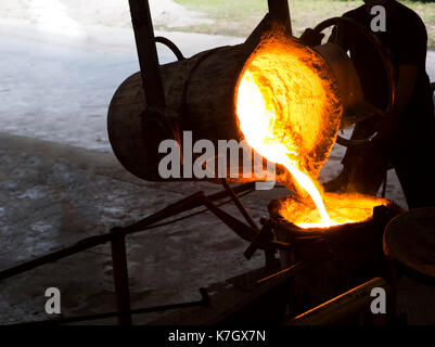Molten iron molten metal poured in to ladle ; foundry factory - Stock Photo
