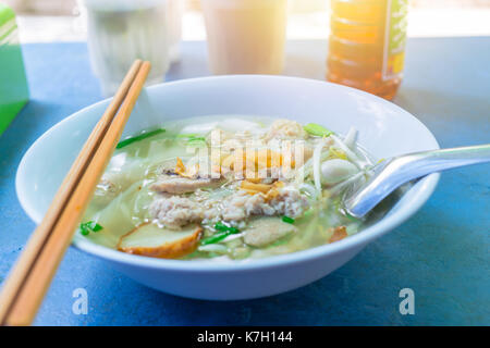 Thai Chinese style noodle with beansprout. Street food lunch in Thailand. - Stock Photo