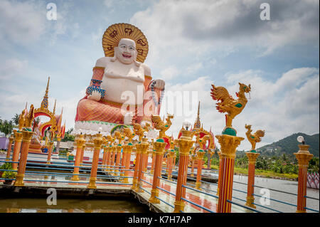 Budai at Wat Plai Leam, a Buddhist temple on the island of Ko Samui, Thailand. - Stock Photo