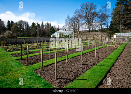 Garden beds and a greenhouse in Balmoral Castle gardens, Scotland - Stock Photo