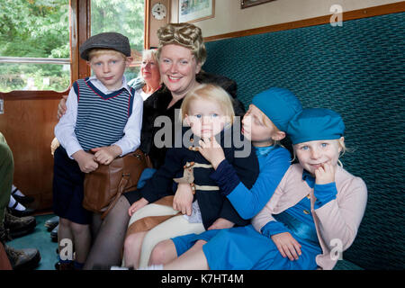 Holt, Norfolk, UK. 16th September 2017. A family of 1940s evacuees take a trip along North Norfolk Railway's Poppy - Stock Photo