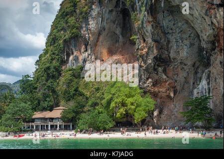 Tourists on the beach. Limestone rocks of South Thailand - Stock Photo