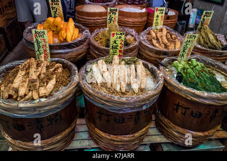 Kyoto, Japan -  May 17, 2017:Preserved vegetables, tsukemono, in wooden barrels for sale on the Nishiki market - Stock Photo