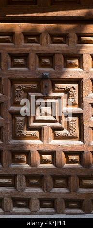 Ancient carved wooden doorway in Santo Domingo de la Calzada in  La Rioja, Spain - Stock Photo