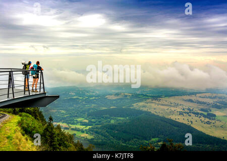Walkers on a viewing platform facing the Limagne plain from Volcano of Puy de Dome. Auvergne. France - Stock Photo