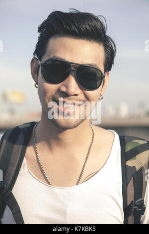 portrait toothy smiling face of asian younger man - Stock Photo