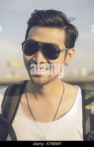 face of asian younger man toothy smiling face happiness emotion - Stock Photo