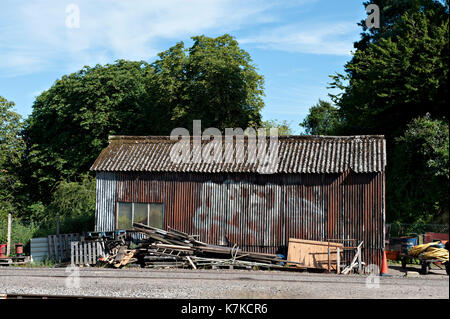 A corrugated iron structure seen at Yeovil Junction Railway Station - Stock Photo