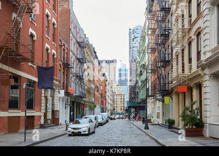 Soho empty street with cast iron buildings in New York. The district name comes from South of Houston Street. - Stock Photo