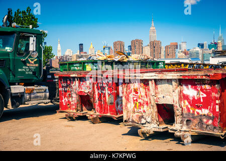 View to New York City, Manhattan over truck containers with trash - Stock Photo