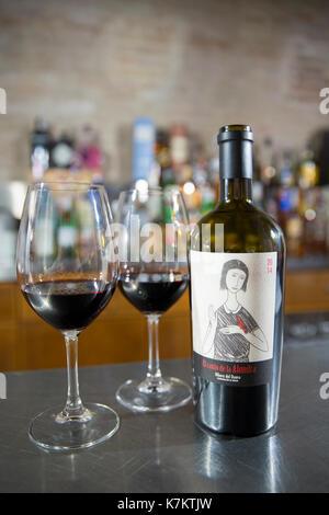 Glasses and bottle of red wine of El Canto de la Alondra, ribera del Duero wine in a bar by River Duero, Navarro, - Stock Photo