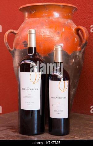 Bottles of red wine Finca Villacreces, Ribera del Duero bodega wine production by River Duero, Navarro, Spain - Stock Photo