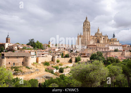 Famous view of Alcazar Castle - palace and fortress which inspired Disney castle, and Cathedral, Segovia, Spain - Stock Photo