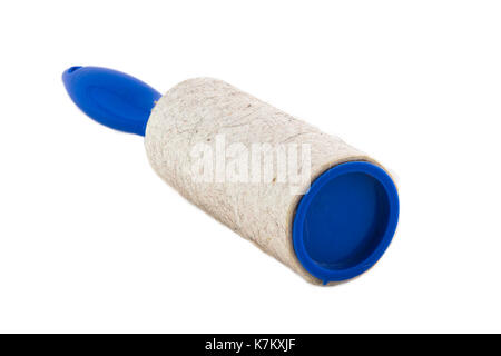 Dirty Adhesive roller for cleaning clothes from animal fur and hair isolated on white background photo. Beautiful - Stock Photo