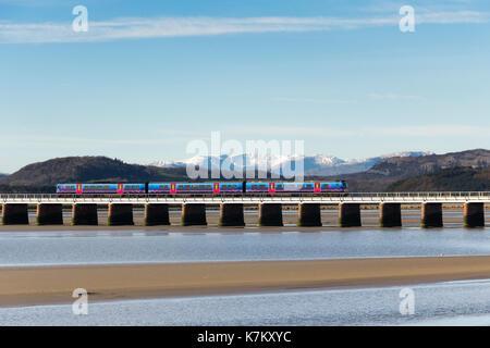 A First TransPennine Express Class 185 diesel multiple unit passenger train crossing Arnside railway viaduct over - Stock Photo