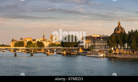 Sunset on the Seine River, Ile de la Cite and The French Institute in Summer. Paris, France - Stock Photo