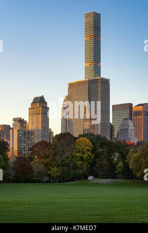 432 Park Avenue skyscraper at sunrise from Central Park Sheep Meadow. Manhattan, New York CIty - Stock Photo