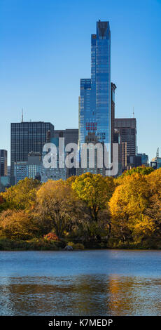 One57 skyscraper and the Central Park Lake in Fall. Manhattan, Midtown, New York City - Stock Photo