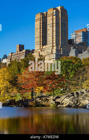 The Majestic building on Upper West Side and the Lake in Central Park in Fall. Manhattan, New York City - Stock Photo