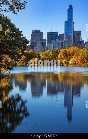One57 skyscraper and The Lake in Central Park in Fall. Manhattan, New York City - Stock Photo