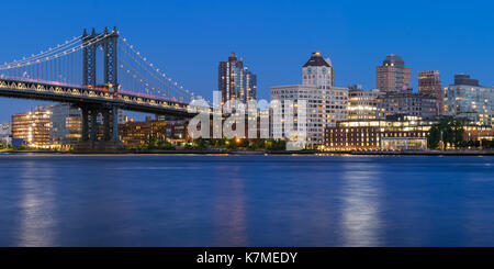 Brooklyn waterfront next to the Manhattan Bridge (DUMBO neighborhood - Main Street Park) at twilight. New York CIty - Stock Photo