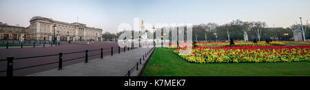 Square panorama with Queen Victoria memorial and flower-beds in front of Buckingam Palace, London, England - Stock Photo