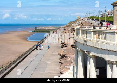Tourists stroll along the promenade at North Shore, Blackpool, Lancashire, UK - Stock Photo