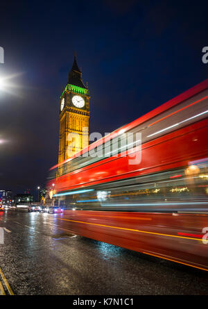 Red double-decker bus in front of Big Ben, Houses of Parliament, motion blur, night scene, City of Westminster, - Stock Photo