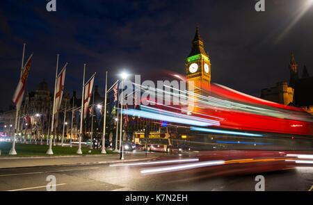 Red double-decker bus in front of Big Ben, Houses of Parliament, light tracks, night scene, City of Westminster, - Stock Photo
