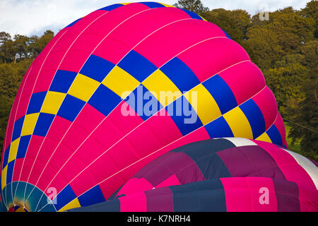 Pink hot air balloons being inflated at Sky Safari hot air balloons festival at Longleat, Wiltshire UK in September - Stock Photo