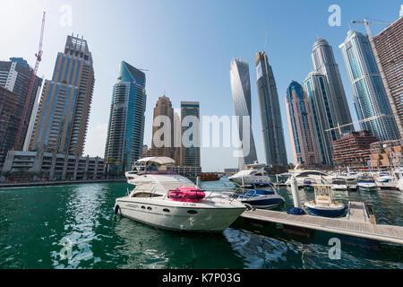 Marina in front of skyscrapers, Dubai Marina, Dubai, United Arab Emirates - Stock Photo