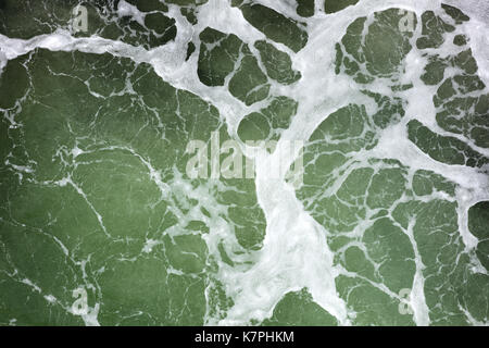 foam on the surface of the green ocean - Stock Photo