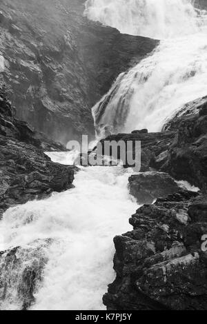 waterfall from the melting of a glacier in norway, black and white photography - Stock Photo