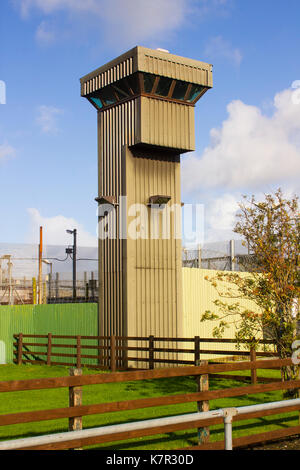 The high observation towers and security fencing at the entrance to the Magilligan Prison in County Londonderry - Stock Photo