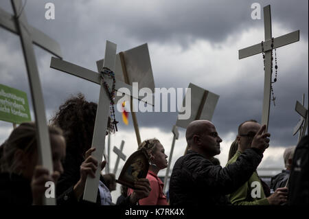 Berlin, Germany. 16th Sep, 2017. Participants in ''The March For Life'' are seen carrying crosses as they march - Stock Photo