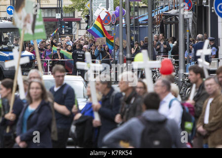 Berlin, Germany. 16th Sep, 2017. Pro-choice protestors wave rainbow pride flags and chant slogans towards participants - Stock Photo