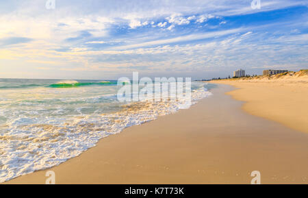 A wave breaking on the shores of Scarborough Beach. Perth, Australia - Stock Photo