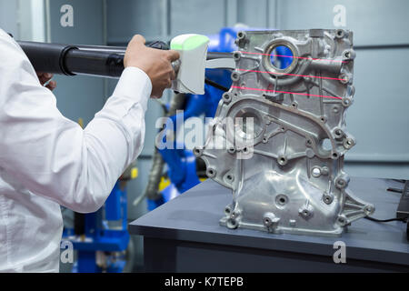 Engineer working with 3D portable measuring scan automotive part in smart factory, Industry 4.0 concept - Stock Photo