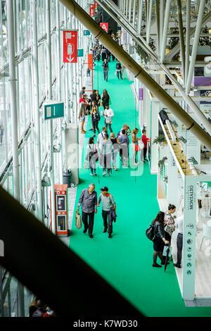 Bologna, Italy, 10 Sep 2017:  people walk in an exhibition pavilion of Fiera di Bologna (Bologna fair) - Stock Photo