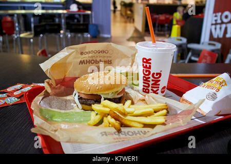 burger king meal on a tray in a restaurant in a regional airport in the uk at night - Stock Photo