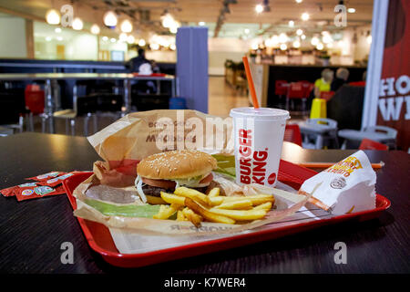 burger king meal on a tray in a restaurant in a regional airport in the uk at night waiting on a delayed flight - Stock Photo