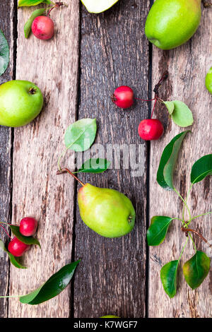 Pear and small apple on wooden rustic background. Top view. Frame. Autumn harvest - Stock Photo
